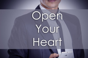 72840048 - open your heart - young businessman with text - business concept - horizontal image